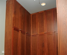 Kitchen: Storage area of stained cherry wood cabinets.