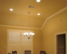 Sloped ceiling with crown molding.
