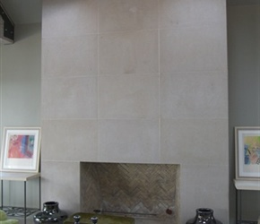 Fireplace: Full masonry fireplace with herringbone fire brick pattern and cut Lueders stone front.