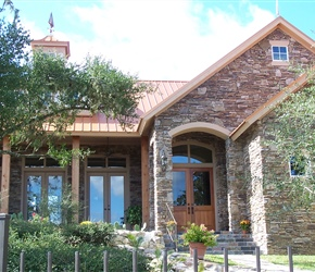 Elevation: Drystack synthetic stone, slate tile on porches