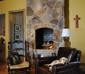 Interior: Full masonry fireplace and saltillo tile floors