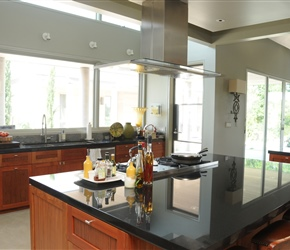 Kitchen: Granite counters and Euro-style Cherry wood cabinets.
