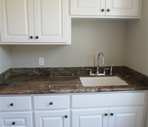 Site built custom made cabinets by TCC; Verde Granite w/ backsplash of Shimmer Peridot