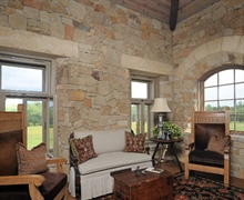 Interior: Combination of straight and arched stone lintels.