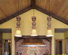 Kitchen: Stained knotty pine vaulted ceilings, copper vent hood, brick backsplash.