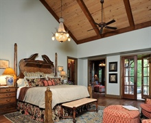 Master Suite: White oak stained hard wood floors, stained knotty pine ceilings.