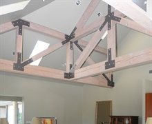Interior: Exposed steel plate connections on timber trusses made of fir.