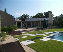 Rear view including pool and modern landscape design