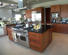 Kitchen: Euro-style cabinets made of Cherry wood with granite counters and dyed concrete floors.